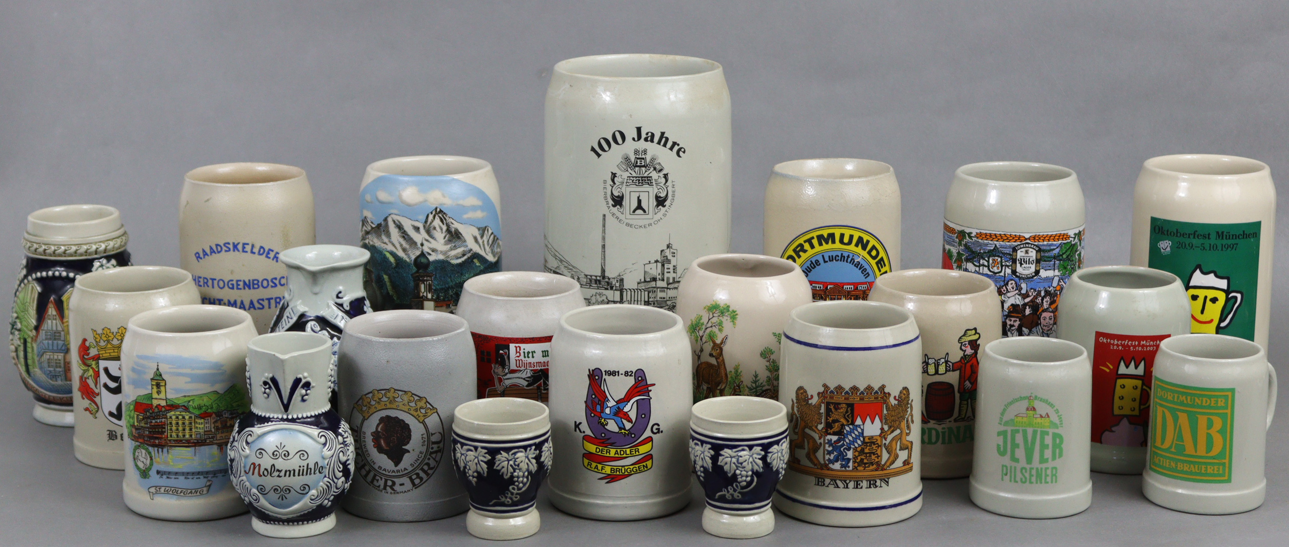 A collection of twenty-two various pottery tankards & beer steins.