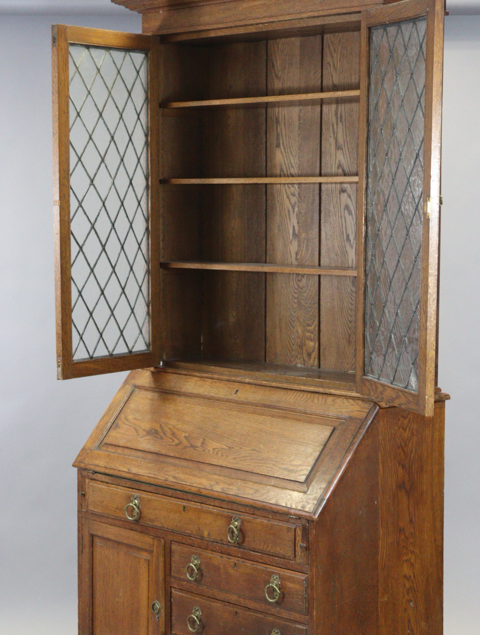 A late 19th/early 20th century oak bureau-bookcase with moulded cornice above a pair of leaded - Image 4 of 7