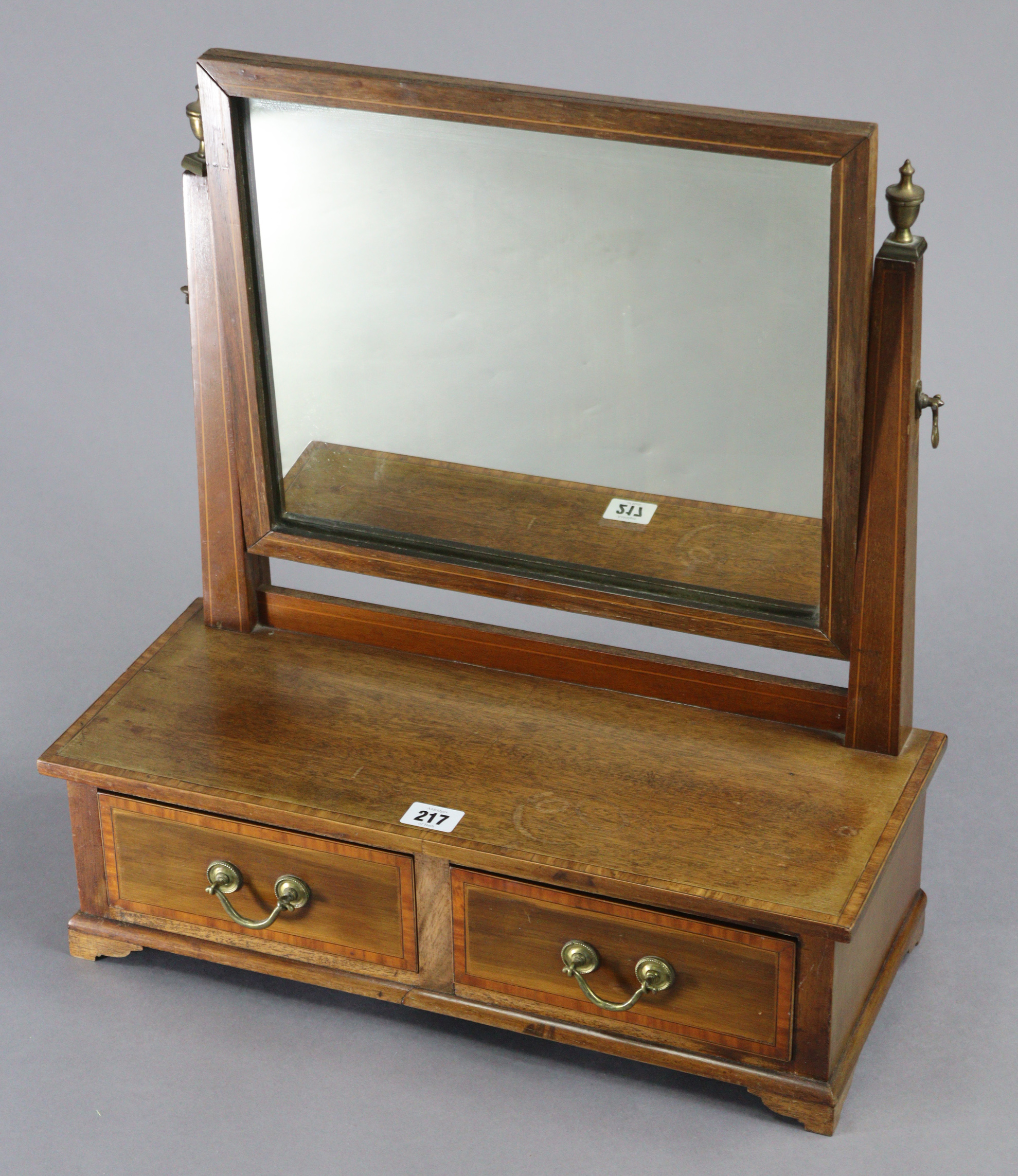 An Edwardian inlaid mahogany rectangular swing toilet glass, fitted two small drawers to the box