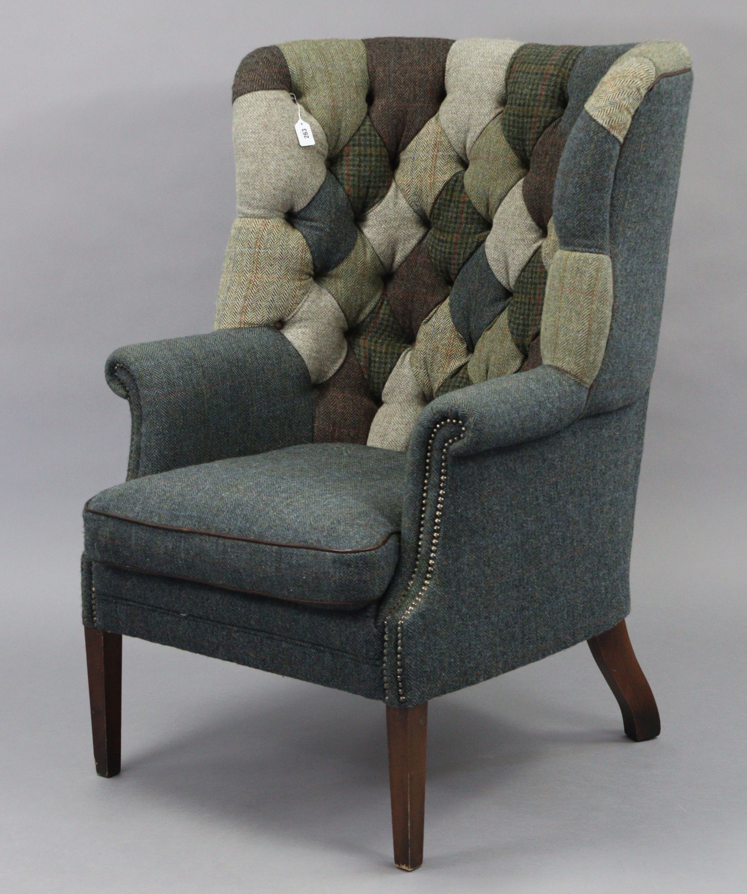 A Tetrad Harris Tweed Mackenzie buttoned-back armchair upholstered multi-coloured material, & on