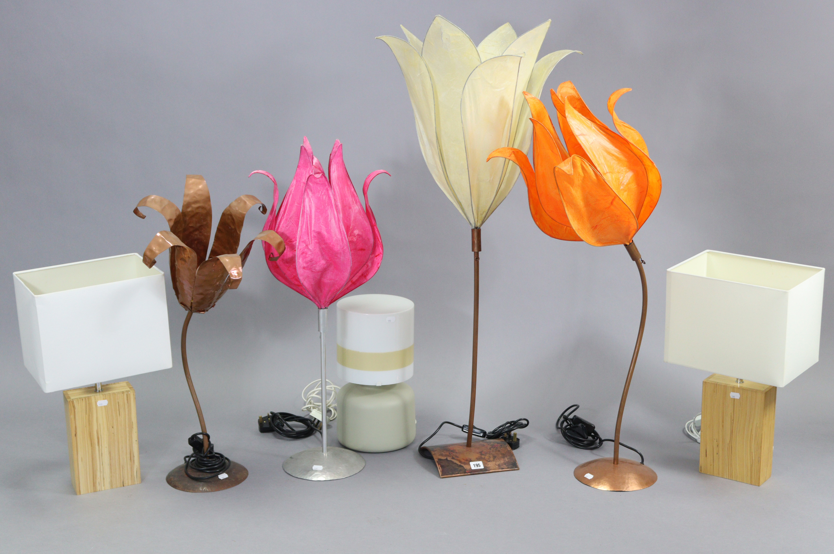 Four metal table lamps, each with floral-design shade; together with three other table lamps.