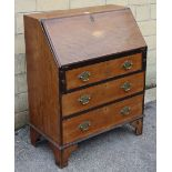A late 19th century inlaid mahogany small bureau with fitted interior enclosed by fall-front above