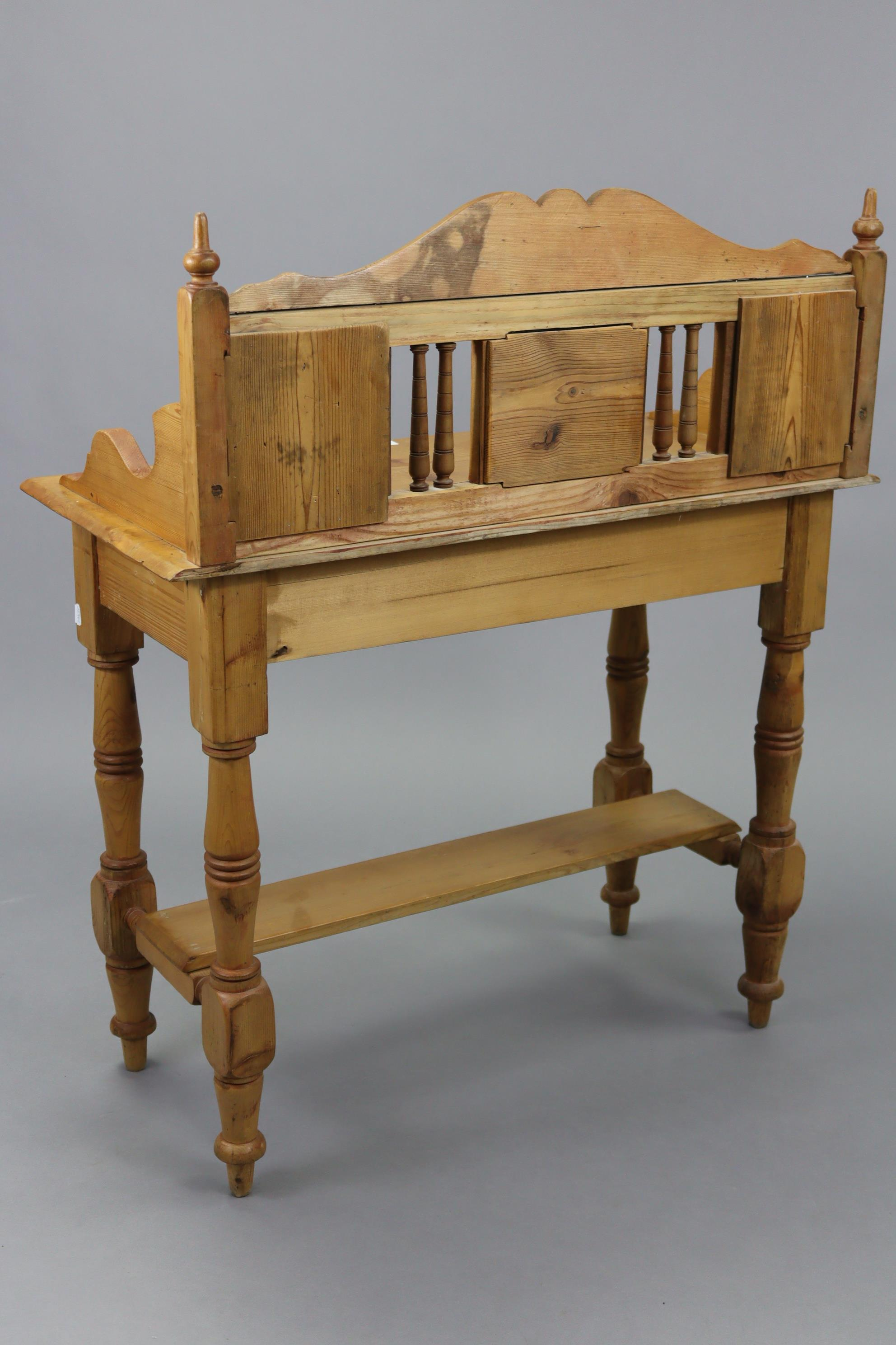 A pine washstand, inset tiles to the stage back, fitted frieze drawer, & on turned legs with open - Image 4 of 4