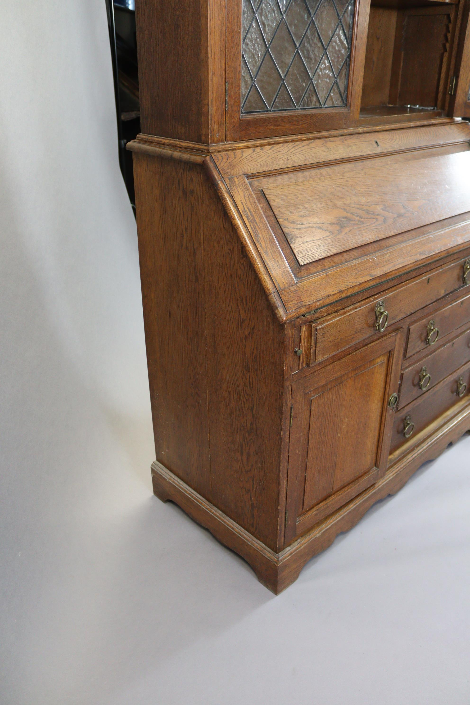 A late 19th/early 20th century oak bureau-bookcase with moulded cornice above a pair of leaded - Image 6 of 7