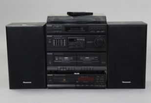 A Panasonic stacking hi/fi system with remote control.