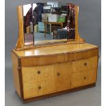 A mid-20th century birds-eye-maple bow-front dressing chest (bears label Tudor Rose), with triple-