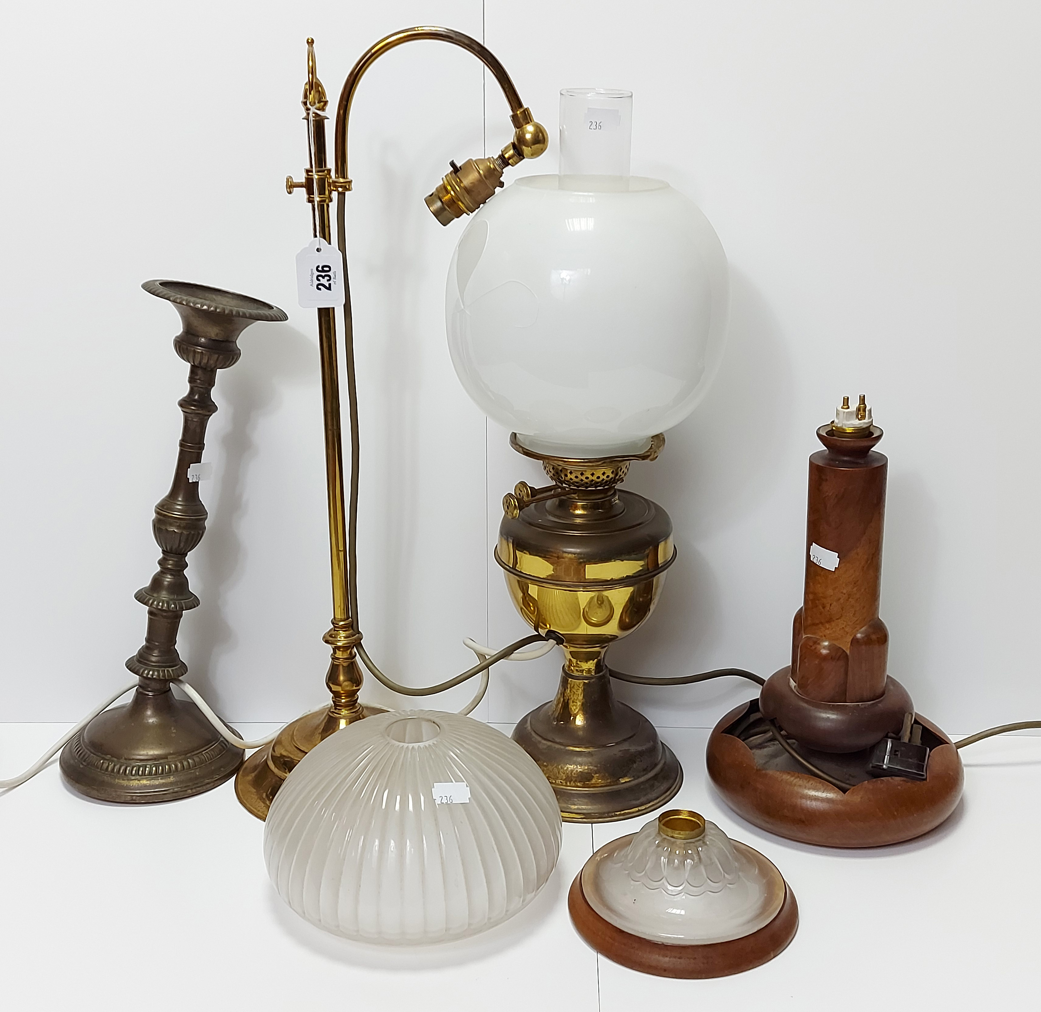 """An Edwardian style brass desk lamp with scroll-arm, & on circular base, 22"""" high; together with"""