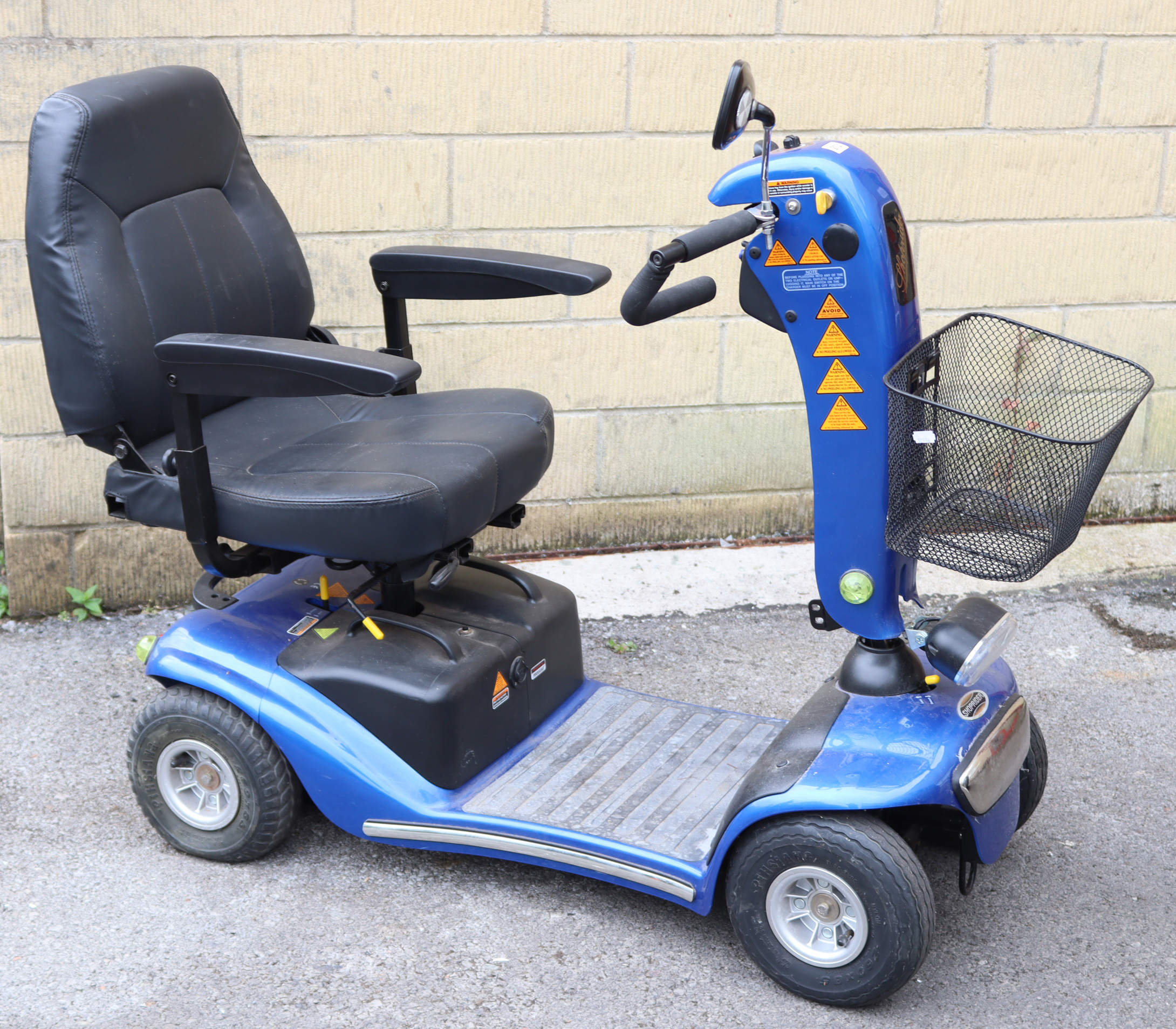 A Shoprider mobility scooter with battery, charger, & key.