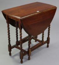 "A 1930's oak small oval gate-leg table on barley-twist legs & turned feet with plain stretchers, 30"""