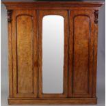 A Victorian hanging mahogany wardrobe with moulded cornice, enclosed centre mirror door, a panel