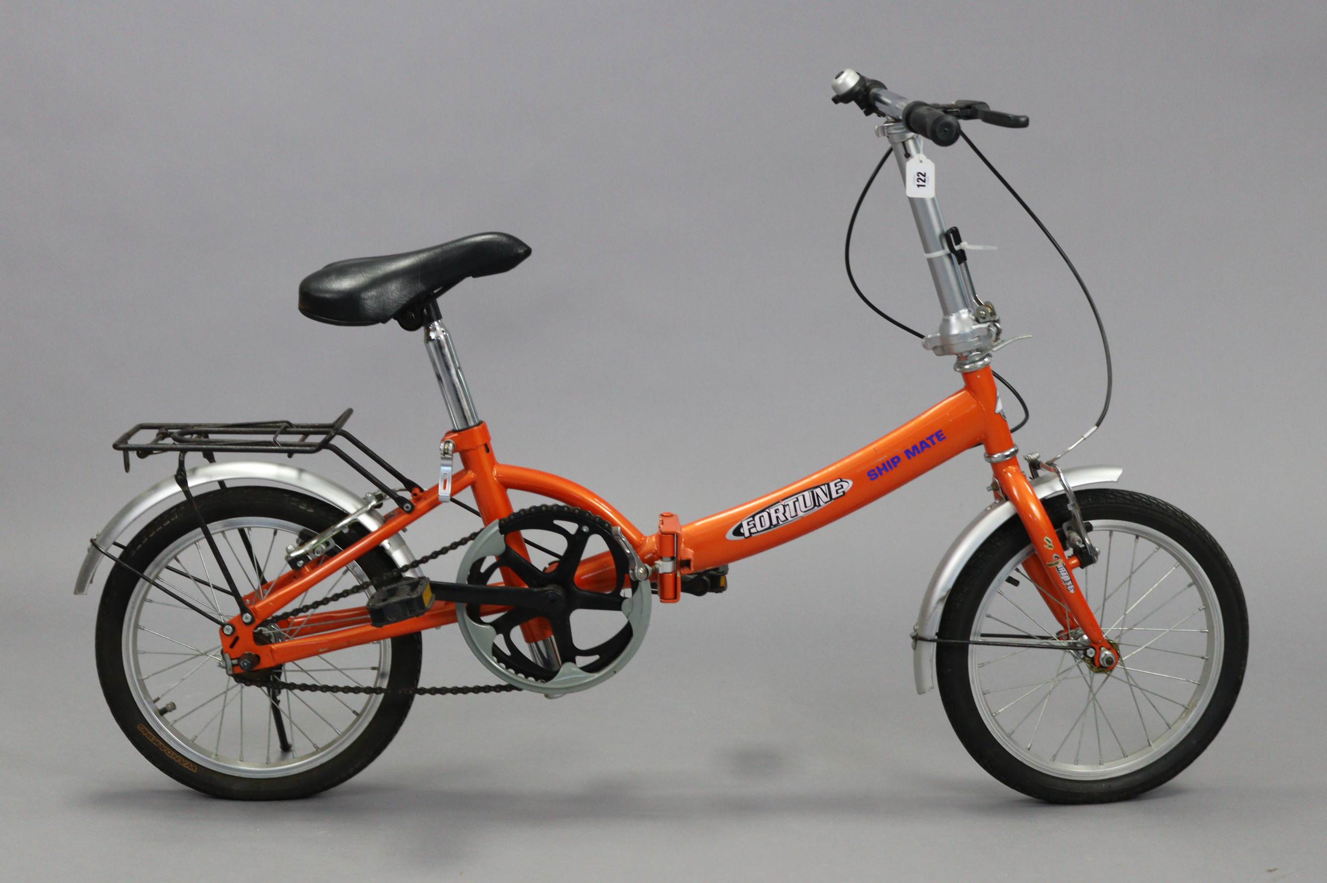 """A Fortune """"Ship-mate"""" folding bicycle (orange)."""