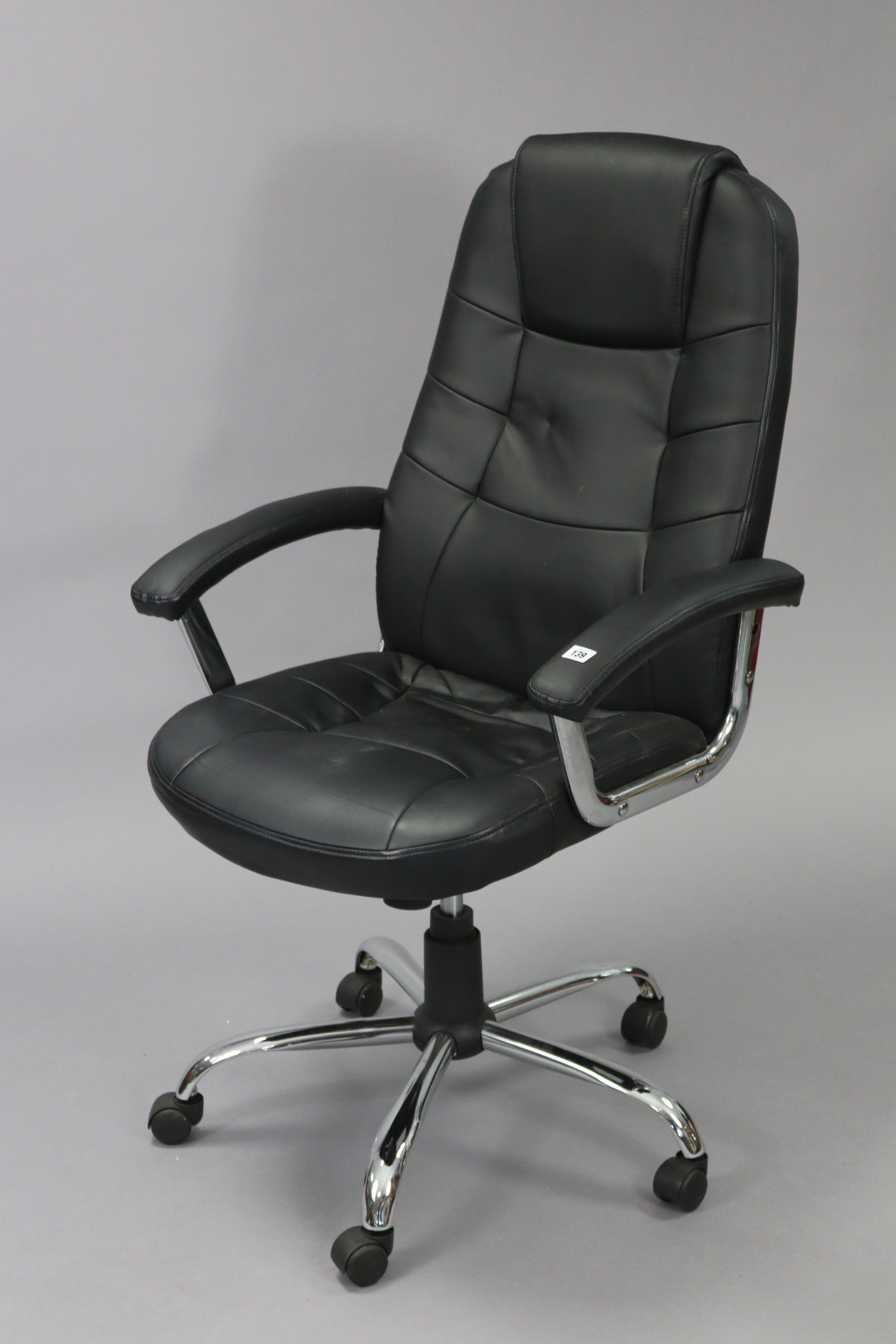 A black leatherette & silvered-metal swivel desk chair.