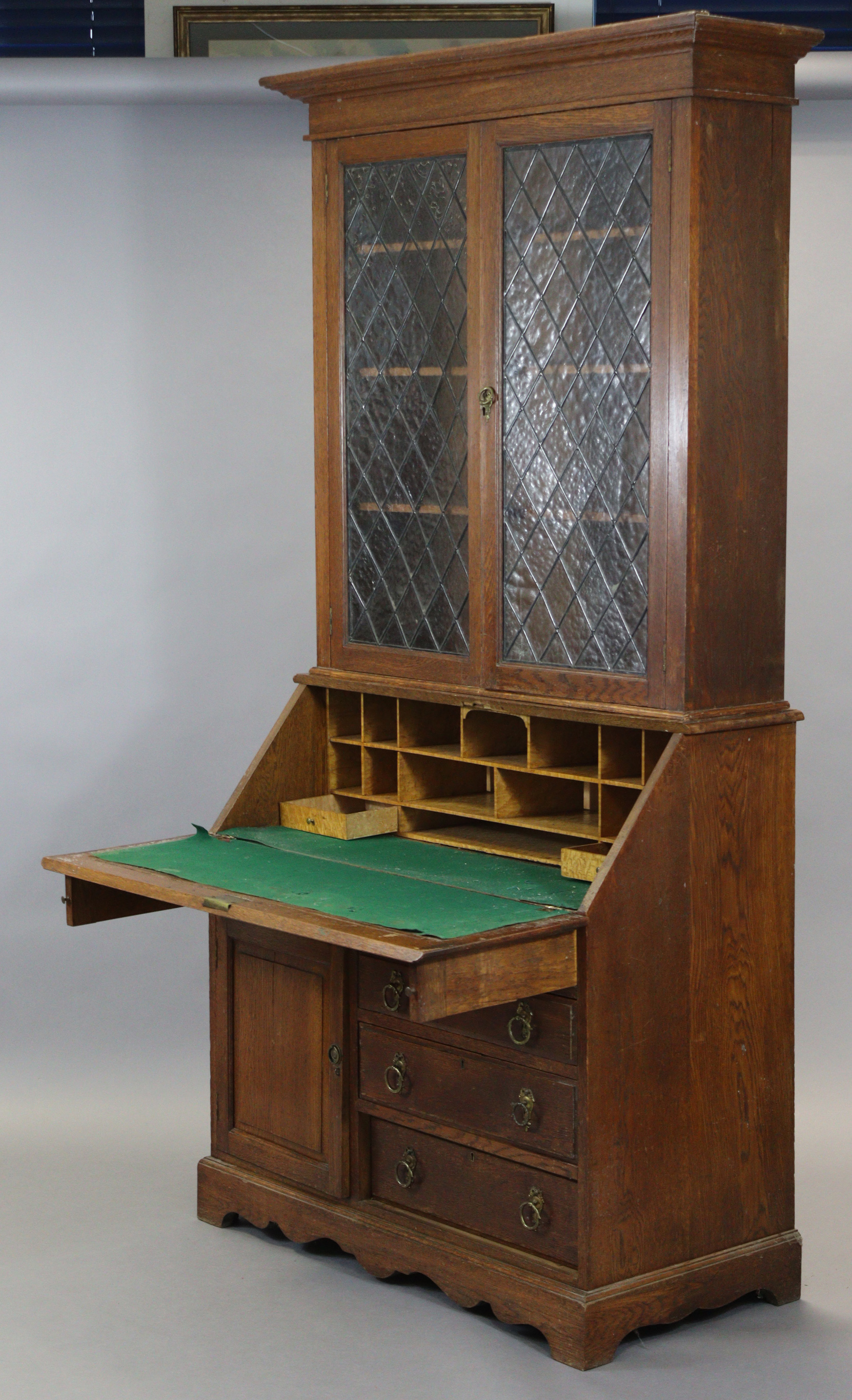 A late 19th/early 20th century oak bureau-bookcase with moulded cornice above a pair of leaded - Image 3 of 7
