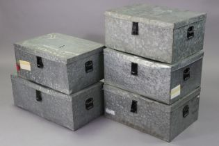 Five tin trunks (various sizes).