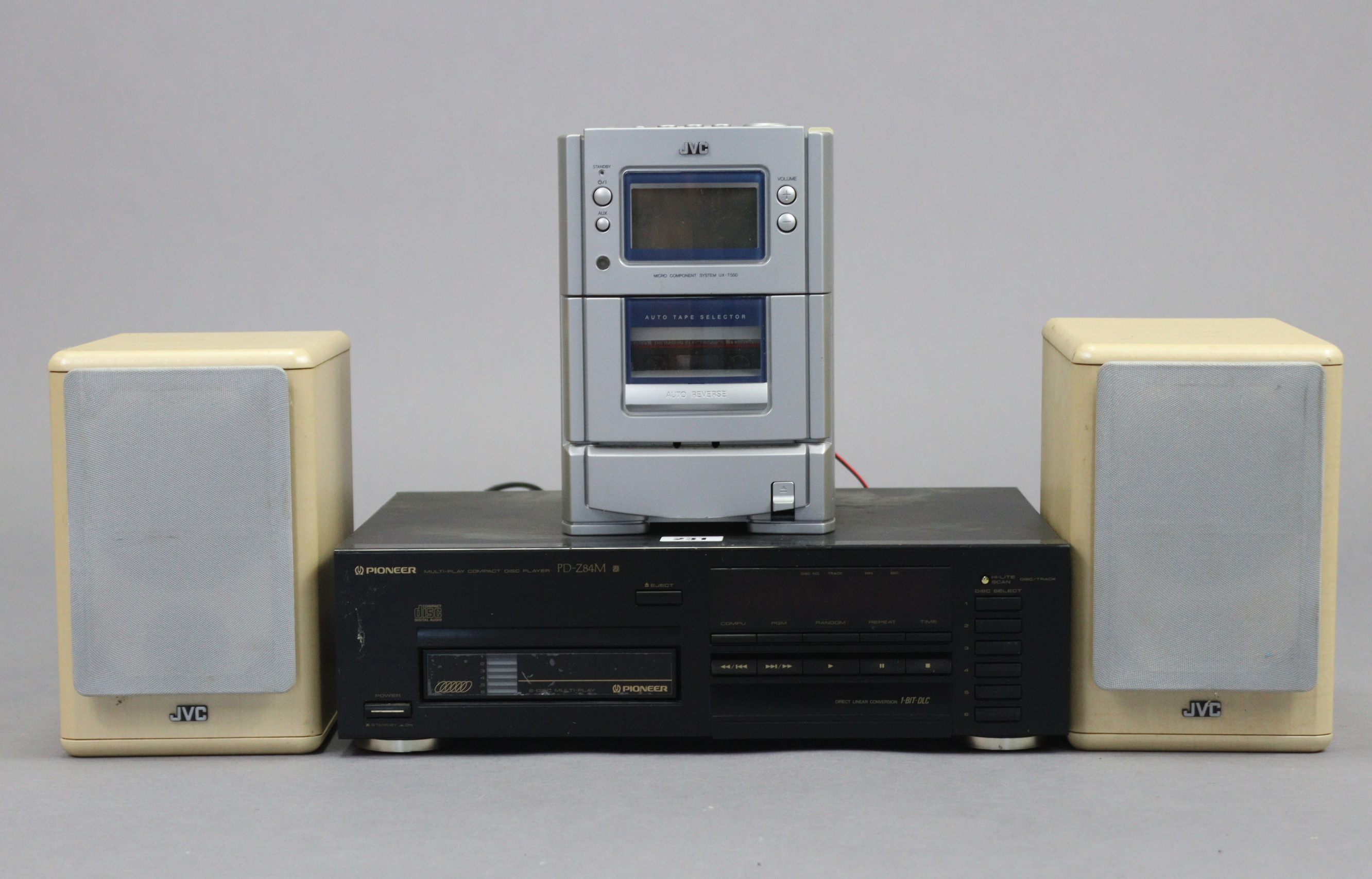 A Pioneer compact disc player (PD-Z84M); & a JVC micro component system.