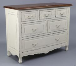 A modern continental-style cream painted wooden chest fitted with an arrangement of six drawers with