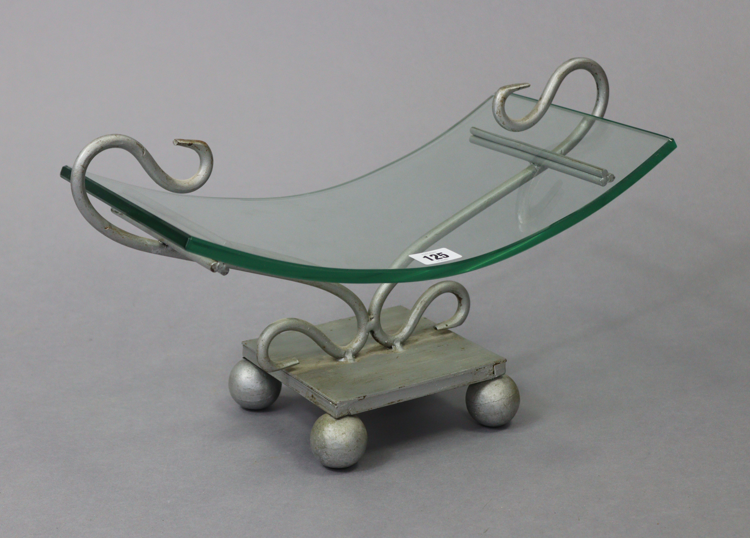 """A contemporary glass fruit dish on a silvered-metal stand, 17½"""" wide; together with various items of"""
