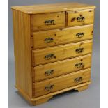 A pine upright chest fitted two short & four long drawers with brass swan-neck handles, & on bracket