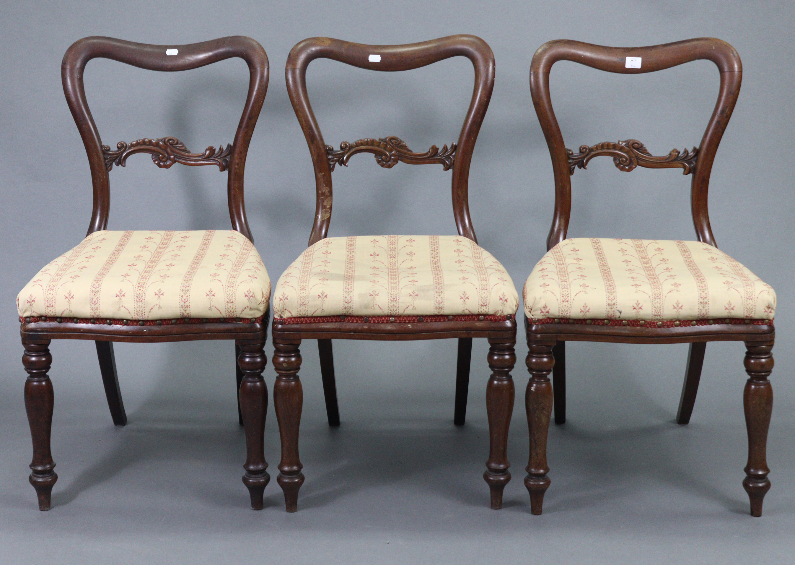 A set of three 19th century mahogany dining chairs, each with carved rail to the kidney-shaped