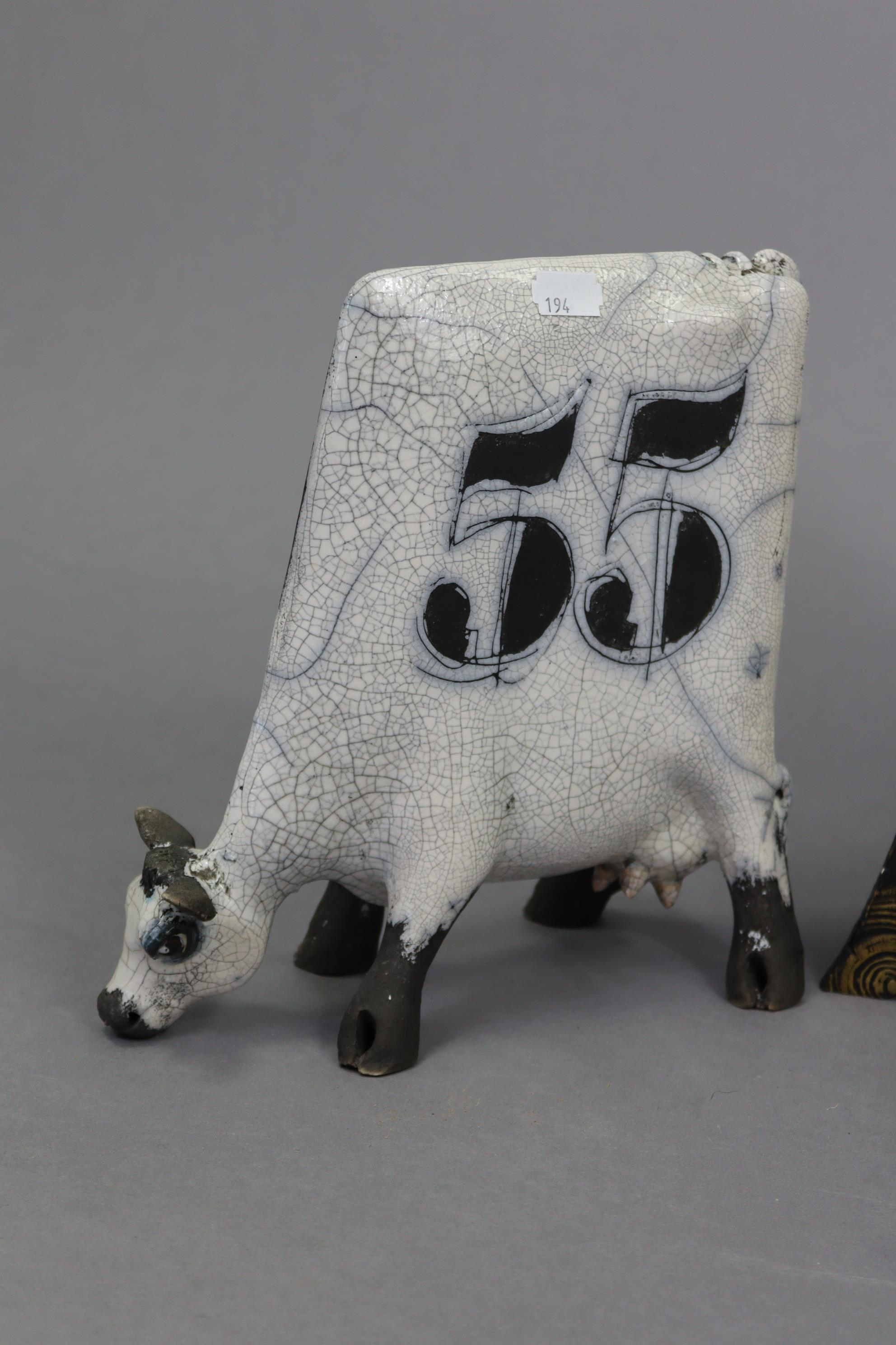 """A mantel clock in black glazed pottery case, 19¼"""" high; a contemporary pottery model of a cow, - Image 2 of 9"""