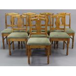 A set of eight Ducal pine splat-back dining chairs with padded seats, & on turned legs with