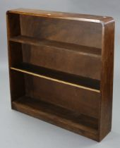 An oak standing open bookcase with two adjustable shelves, square tapered end supports, & on