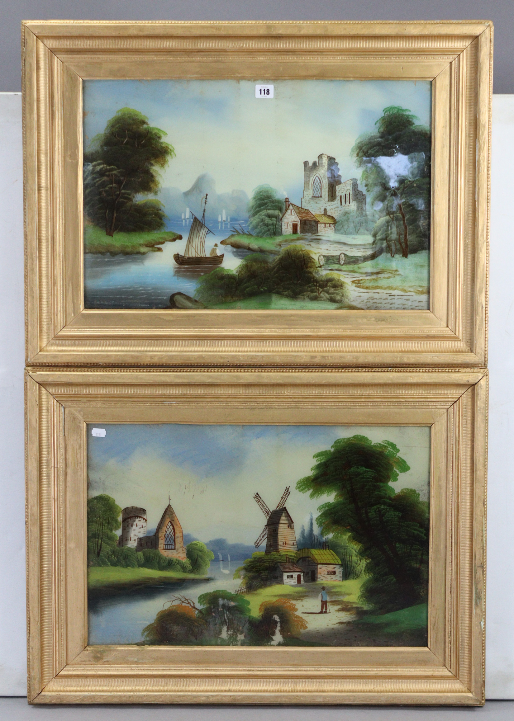 """A pair of reverse paintings on glass-continental river scenes, 15½"""" x 23½"""", in matching gilt"""