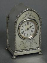 An Edwardian silver lancet-cased timepiece with raised husk border & engraved leaf-scroll