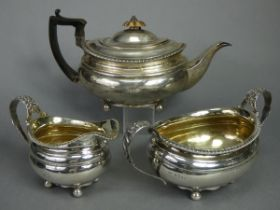 A regency silver matched three-piece tea service of oval form with silver-gilt interiors & gadrooned