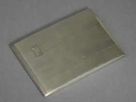A silver engine-turned cigarette case with engraved initials to one side, the interior engraved with