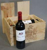 Six bottles of Chateau Montrose 2001 Saint-Estephe, Grand Cru Classe vintage Bordeaux red wine, in