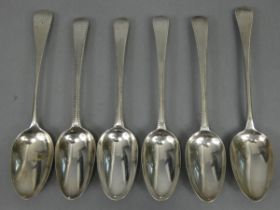 Four George III silver Old English Feather-Edge table spoons: - one pair London 1780 by Hester
