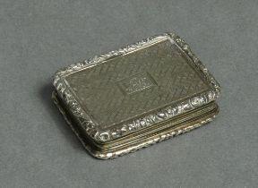 A George IV silver vinaigrette of rectangular shape, engine-turned decoration & carved scroll