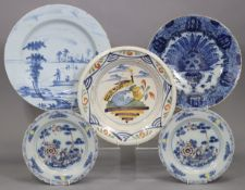 """A pair of 18th century English Delft 9"""" plates with polychrome decoration of a fenced garden (one"""