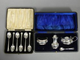 An early 20th century silver three-piece condiment set; Chester 1913 & 14 by George, Nathan, &