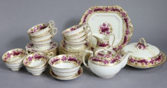 An early 20th century English porcelain tea service in the regency style, the wide borders decorated