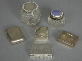 An Edwardian silver rectangular snuff box with engraved scroll decoration, shaped sides, & hinged