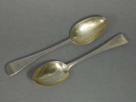 A pair of Victorian silver Old English table spoons with engraved crest to terminals, London 1854 by
