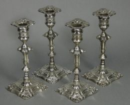 A set of four Edwardian silver candlesticks in the mid-18th century cast style, each with slender