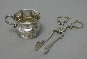 A late 18th century Russian silver vodka cup with eight-sided flared rim, squat round semi-fluted