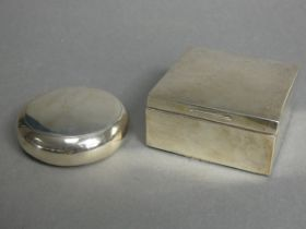 """A George V silver compressed round pocket tobacco pouch with squeeze release to the hinged lid, 3"""""""