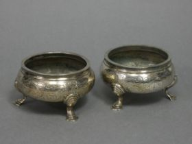 A pair of early Victorian silver squat round salt cellars in the mid-18th century style, each with