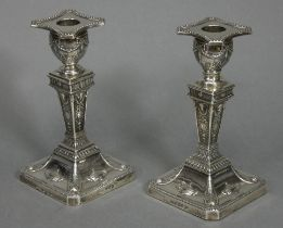 A pair of Victorian silver Adam-style desk candlesticks of square tapered form decorated with rams