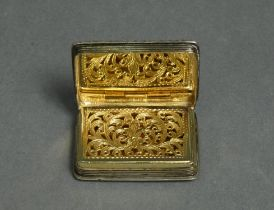 An early Victorian silver vinaigrette of rectangular shape, with engine-turned decoration & carved