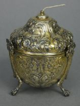 An Edwardian silver-gilt string box of ovoid shape with pull-off ogee lid, all-over embossed