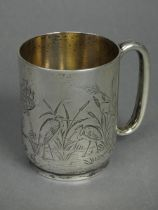 A Victorian silver half-pint mug of straight-sided form with engraved decoration of wading birds