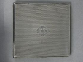 A silver engine-turned pocket cigarette case with engraved Army Chaplain's badge, the interior