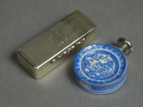 A Victorian silver rectangular engine-turned snuff box with scroll thumb-catch to the hinged lid,
