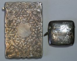 """A Victorian silver card case, with all-over foliate scroll design & hinged lid, 2½"""" x 2¾"""";"""