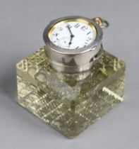 An Edwardian large heavy glass & silver-mounted square inkwell of pale amber colour, with canted